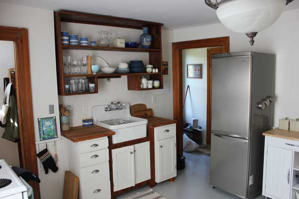 Kitchen cupboard with maple top and shelf